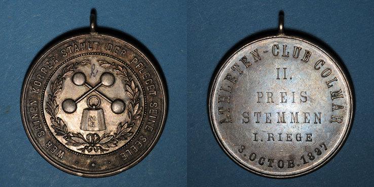 1897 ELSAß Alsace. Colmar. Club athlétique de Colmar. 1897. 2e prix de soulever. Médaille argent. 39,67 mm Petit h écrit à l'encre. Deux coups / tranche sinon vz / TTB