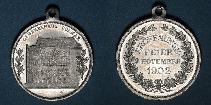 1902 ELSAß Colmar. Inauguration de la Maison du Commerce. 1902. Médaille aluminium. 29,26 mm, avec son oeillet Petits cours / listels sinon ss